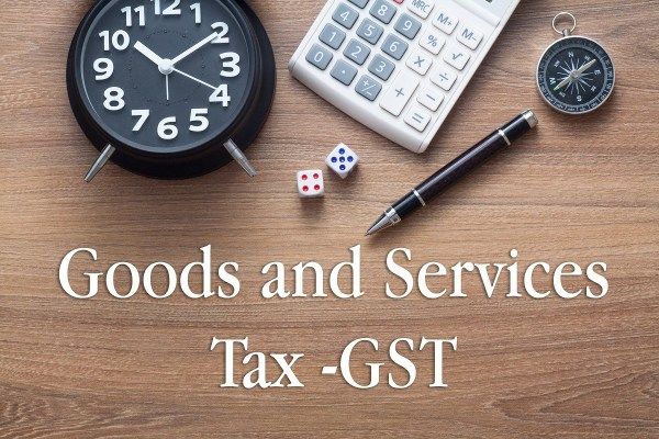Image That Represents the Text Goods and Services Tax - With Calculator, Coins and Clock.
