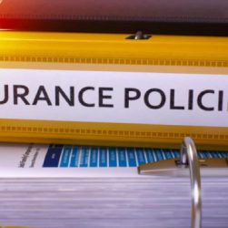 Image Showing An Insurance Policy Book Placed On A Table.