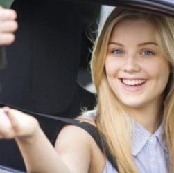 Young Attractive Smiling Woman bought a key.