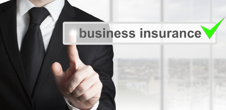 A Business man pointing on business insurance on the screen.