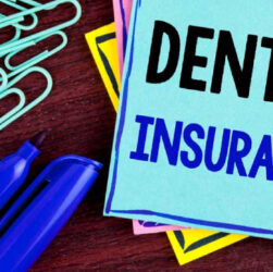 A Text That Represents Dental Insurnce Written On A Note Placed On The Table.